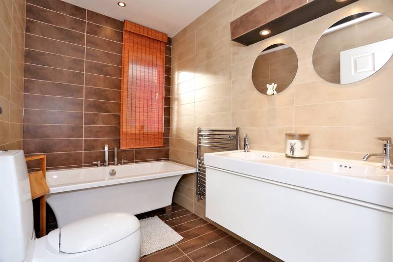 Family Bathroom: Luxurious bathroom fitted with a white suite
