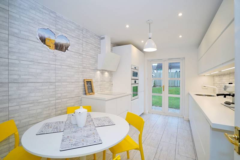 Kitchen Diner: Well-equipped dining kitchen fitted with a comprehensive range of modern base and wall mounted units, benefitting further from French doors leading to rear garden