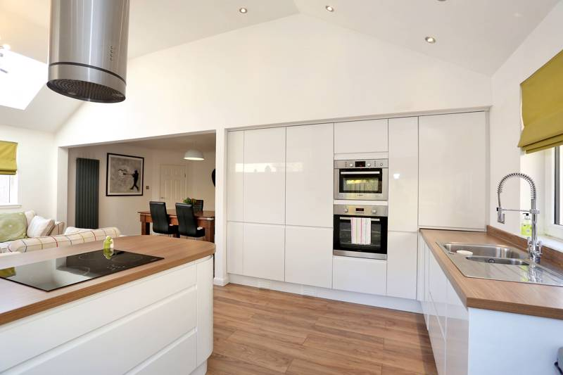 Kitchen: Fitted with a comprehensive range of quality white high gloss base and wall mounted cabinets, and a range of integrated appliances