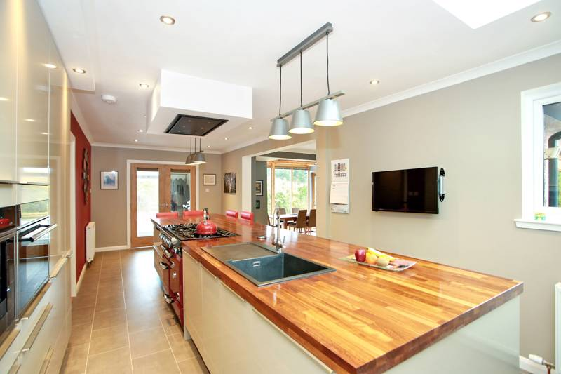 Kitchen: Boasts an exceptionally large work island  and wide selection of quality base and wall units