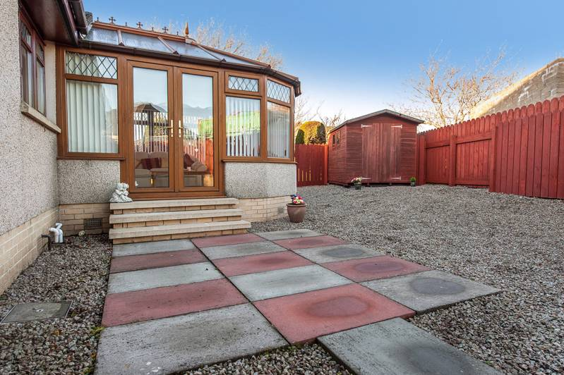Rear Garden: The property enjoys a fully enclosed rear garden, mainly laid with stone chips for easy maintenance