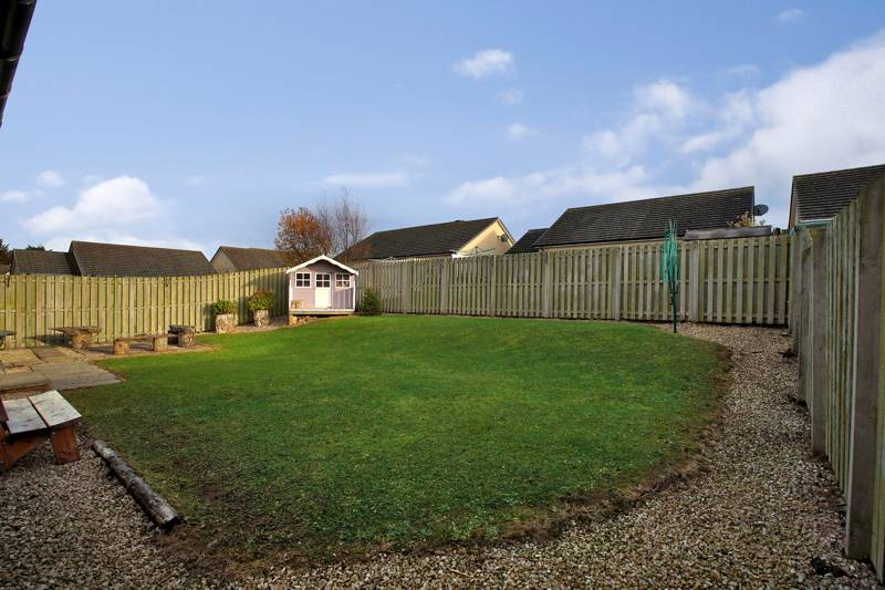 Rear Garden: Laid to lawn with a large paved patio area ideal for outdoor entertaining