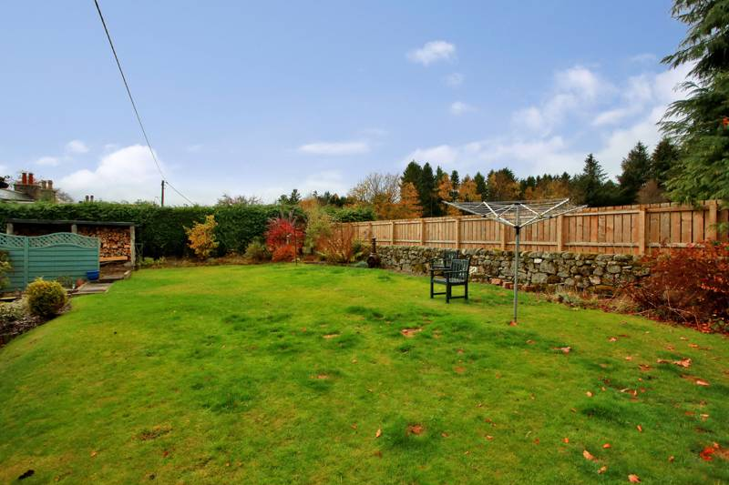 Rear Garden: Fully enclosed and mainly laid to lawn