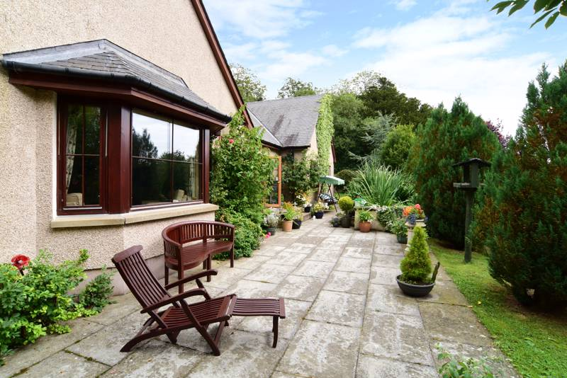 Rear Garden: The outdoor space also benefits from an orchard and patio area