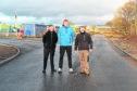 Community councillors Bill Harvey, Allan Strang and Sean MacIntyre examine the surface.