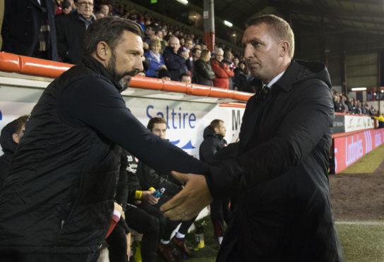 Aberdeen manager Derek McInnes (left) with Brendan Rodgers.