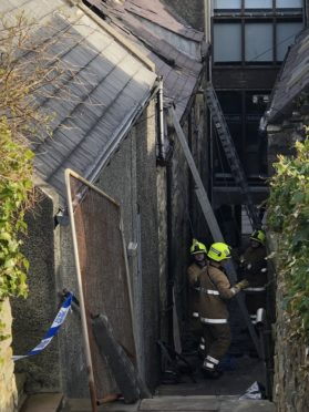 Emergency services were called to the blaze in a two-storey dwelling house in Burns Lane just before midnight on Saturday evening.