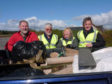 George Niblock (right) with other volunteers  litter picking story