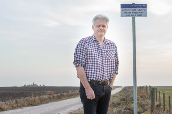 Councillor Alan Fakley was one of the people campaigning for dog safety at Slain Castle and is glad a sign has been put up near the castle grounds to warn pet owners of the hazards.