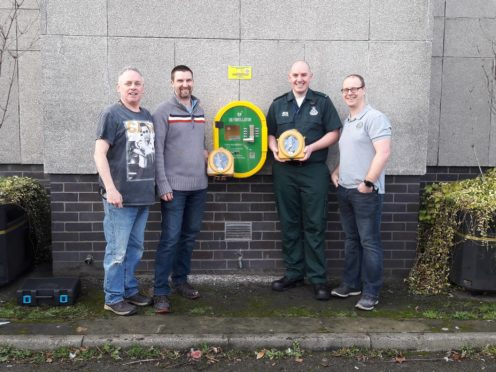 L-R: Dave Chapman, Ken Glass of Defibs for Moray, Ambulance technician Greg Winter and Willie Hardie with the new defibrillator installed at Elgin Town Hall