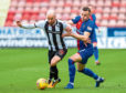 Dunfermline's James Vincent (L) competes with Darren McCauley.