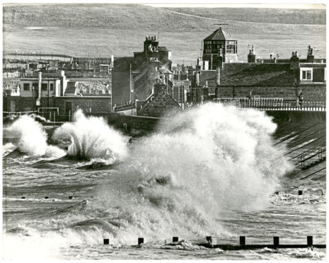 Angry seas pound the ramparts of Footdee.