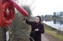 Torry councillor Catriona Mackenzie inspects the frayed rope on the River Dee lifebelt
