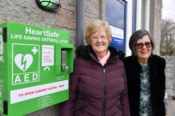 Catra vice chairwoman Rita Cartney and chairwoman Julie Pickering with the new defibrillator at Crimond Primary School.