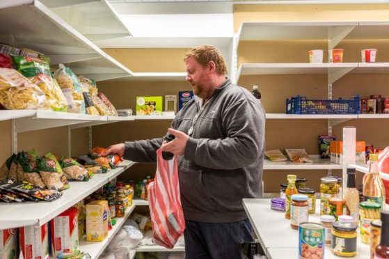 A man in the pantry at CFINE