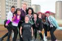 Glasgow Girls cast members, from left, Patricia Panther, Stephanie McGregor, Kara Swinney, Sophia Lewis, Chaira Sparks, Shannon Swan and Aryana Ramikhalawon.
