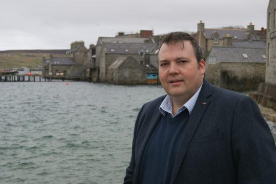 Jamie Halcro Johnson MSP in Lerwick bay, Shetland