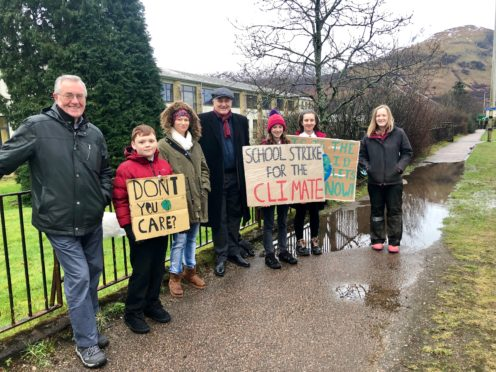 MSP John Finnie joins Holly Gillibrand and fellow students in strike outside Lochaber High School.