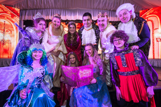 Danya Smith who plays Sleeping Beauty, back row third from left, with other members of the cast.