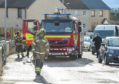Fire crews at the damaged property in Lossiemouth.