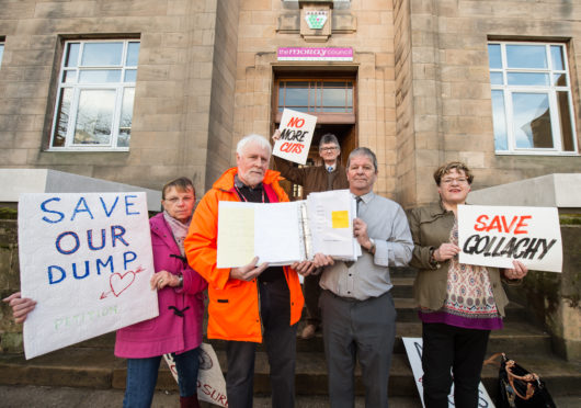Picture by JASON HEDGES      Buckie and Lennox town community councils hand over a petition to stop the closure of the Gallachy dump in Buckie, Moray.  Picture: