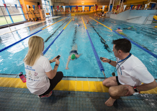 Picture by JASON HEDGES  Rotary Elgin's Triple Challenge starts with a swimming event at Moray leisure centre, Elgin.  Picture: Issie Graham finishes