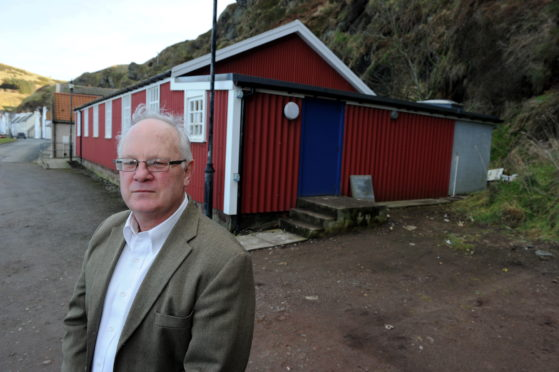 Pennan Community Councillor Bill Pitt outside the village hall.