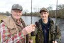 Anglers and club members, John Brocklehurst and Jim Braithwaite toast to a successful season ahead.