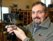 Alister Bowie, Manager of Ffordes near Beauly with the Gold Customer Service award.