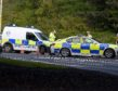 Police deal with the accident involving a car and a pedestrian at the Raigmore Interchange in Inverness. Picture by Sandy McCook.