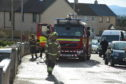 Firefighters at the scene in Lossiemouth. Picture by Jason Hedges.