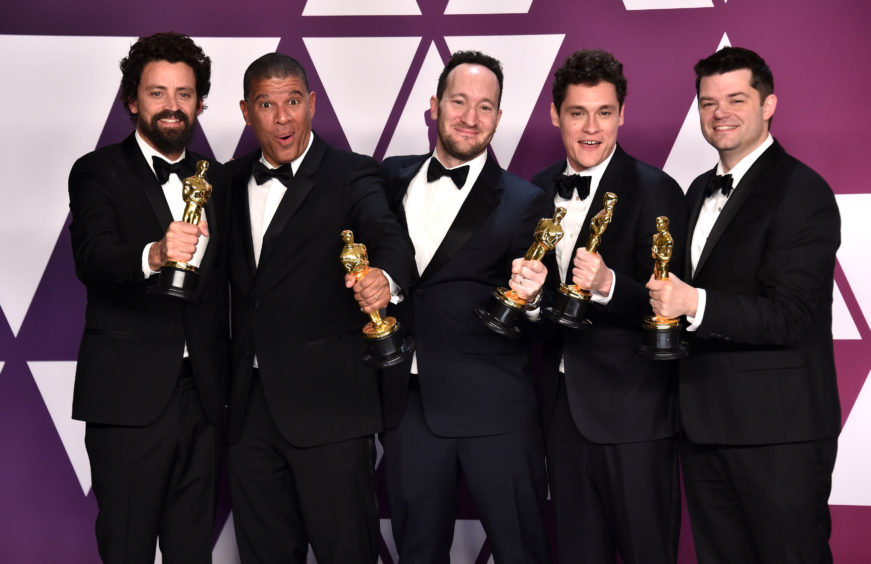 Bob Persichetti, Peter Ramsey, Rodney Rothman, Phil Lord, and Christopher Miller with their Oscars for Best Animated Feature Film for Spider-Man: Into The Spider-Verse.