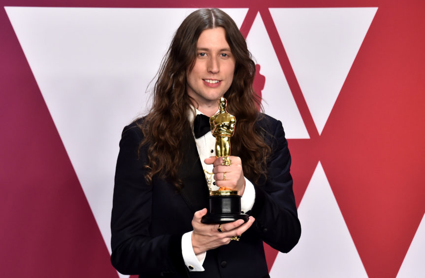 Ludwig Goransson with his award for Best Original Score for Black Panther.
