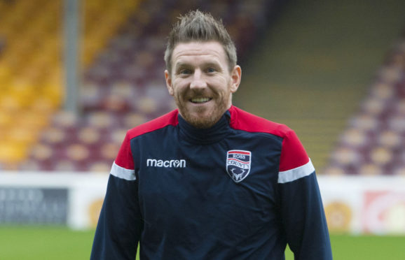 Michael Gardyne has signed a new deal with Ross County.