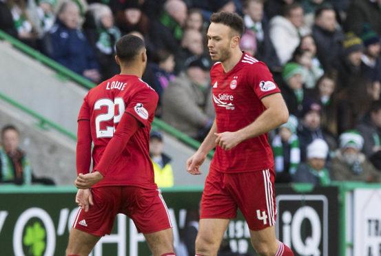 Aberdeen's Andrew Considine (R) celebrates his goal to make it 1-1.