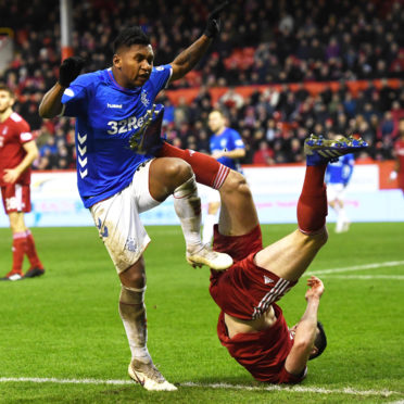 Alfredo Morelos and Scott McKenna tangle.