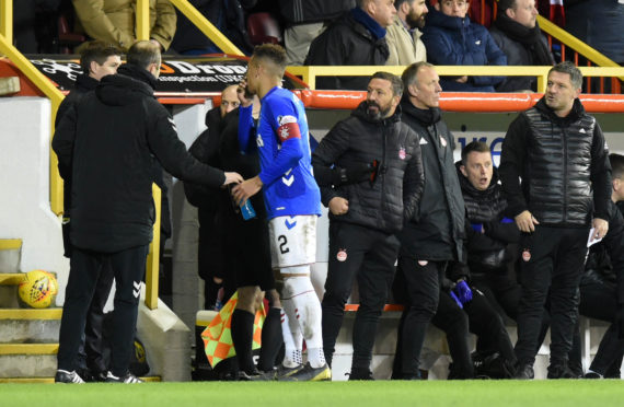 Aberdeen assistant manager Tony Docherty (right) exchanges words with Rangers boss Steven Gerrard.