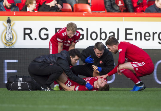 Tommie Hoban was injured in the 2-2 draw with St Mirren.