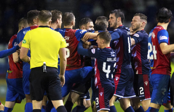 The skirmish between Caley Thistle and Ross County players after Michael Gardyne and Brad McKay clashed.