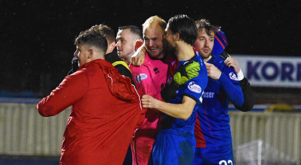 Mark Ridgers is mobbed after Caley Thistle's shootout win in the Scottish Cup.