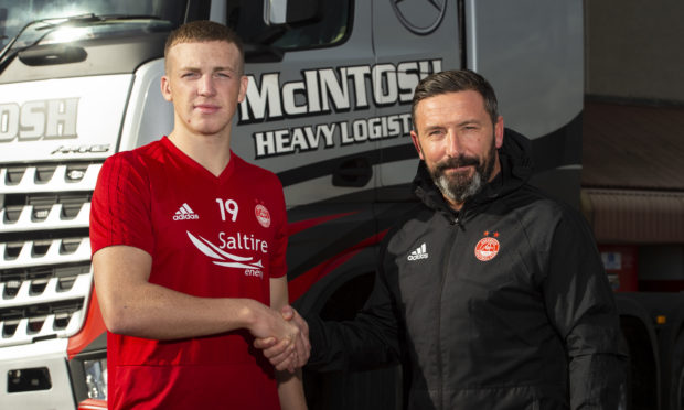 Aberdeen's Lewis Ferguson (left) is pictured with manager Derek McInnes after signing a new deal with the club.