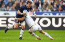 Scotland's Peter Horne takes on France's Romain Ntamack in yesterday's match.