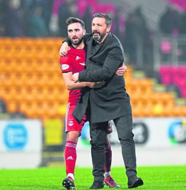 Aberdeen's Graeme Shinnie (L) celebrates at full time with manager Derek McInnes.