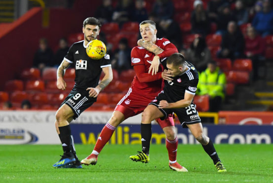 Hamilton's Scott Martin (R) challenges Aberdeen's Lewis Ferguson for the ball
