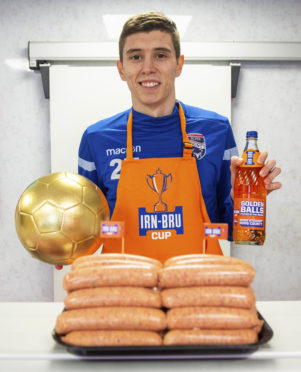 28/02/19 COCKBURN'S BUTCHER - DINGWALL Ross County's Ross Stewart collects his IRN-BRU Cup Goldenballs award for his performance in the semi-final's at local award winning butchers 'George Cockburn & Son' where they are selling IRN-BRU sausages in the run-up to the Cup final.