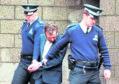 Steven Leisk, 34, is escorted from Aberdeen High Court.