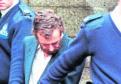 Steven Leisk being escorted from Aberdeen High Court.