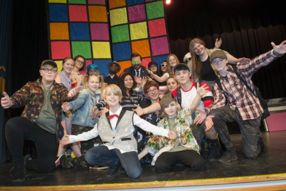 21/02/19  St Machar Academy pupils and staff are all ready to Turn Back Time with 90s chart topping music from the likes of Cher, Backstreet Boys and the Spice Girls by performing in nostalgic musical, it was announced today (Friday 22 February).The talented ensemble will be performing in Popstars the 90's Musical in the school hall on Wednesday 27, Thursday 28 February and Friday 1 March.The musical is about a love-triangle with a pop talent show at the centre of things as a girl band takes on a boy band for the Grand Prize. Fun and hilarity, and more than a few vintage pop classics are guaranteed along the way!