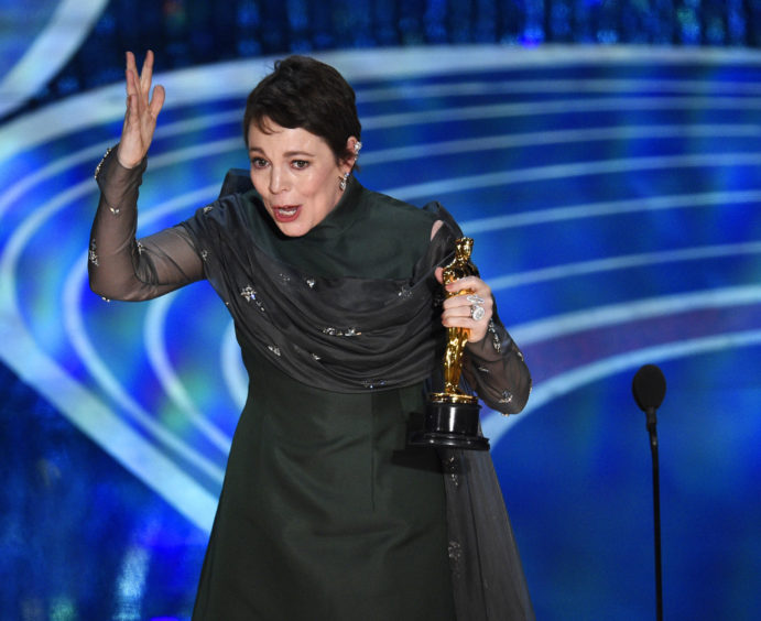 Olivia Colman reacts as she accepts the award for Best Actress In A Leading Role for The Favourite.