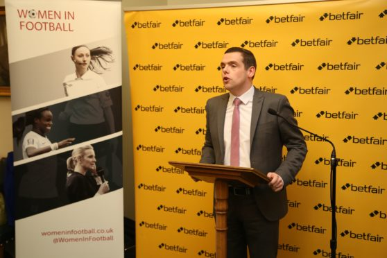 Douglas Ross speaking at the Women in Football reception